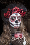 A woman in Halloween costume and skull makeup Stock Images