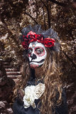 A woman in Halloween costume and skull makeup Royalty Free Stock Images