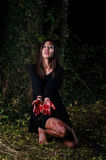Woman halloween girl with blood in the forest at night Royalty Free Stock Images
