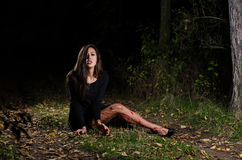 Woman halloween girl with blood in the forest at night Stock Photo