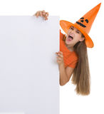 Woman in Halloween hat with blank billboard Royalty Free Stock Photography