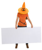Woman with Halloween hat holding blank billboard Royalty Free Stock Photography