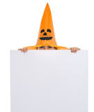 Woman in Halloween hat looking out from billboard Royalty Free Stock Photo