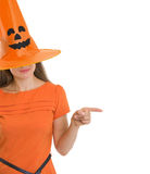 Woman in Halloween hat pointing on copy  space Royalty Free Stock Image
