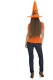 Woman in Halloween hat. Rear view Royalty Free Stock Photography