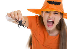 Woman in Halloween hat scaring with spider. Isolated on white Stock Images