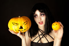 Woman with halloween makeup holding a pumpkin Stock Images
