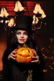 Woman with halloween pumpkin Royalty Free Stock Images
