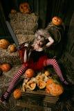 Woman with halloween pumpkin Royalty Free Stock Photos