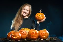 Woman with Halloween pumpkins Stock Image