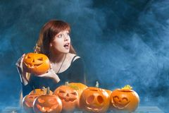 Woman with Halloween pumpkins Stock Photography