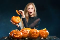 Woman with Halloween pumpkins Royalty Free Stock Photography