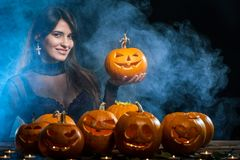 Woman with Halloween pumpkins Royalty Free Stock Photos
