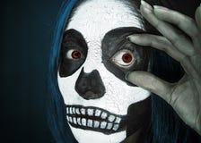 Woman with Halloween skull makeup stock photo