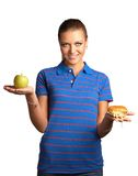 Woman with hamburger and apple Stock Image