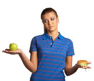 Woman with hamburger and apple Royalty Free Stock Photo