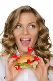 Woman with hamburger from hearts looking away Royalty Free Stock Photography