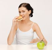 Woman with hamburger and vegetables Stock Images