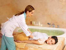 Woman in hammam or turkish bath stock images