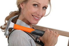 Woman with hammer Royalty Free Stock Photography