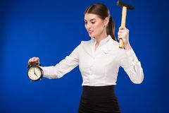 Woman with hammer and alarm clock Royalty Free Stock Images