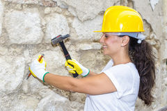 Woman with hammer and chisel Royalty Free Stock Photo