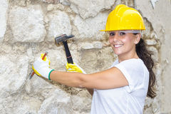 Woman with hammer and chisel Stock Photography