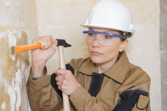 Woman with hammer and chisel in work. Woman with hammer and chisel in the work royalty free stock photography