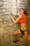 Woman with hammer drill Royalty Free Stock Image