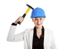 Woman with hammer and hardhat isolated on white Royalty Free Stock Images