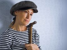 The woman with a hammer Royalty Free Stock Images