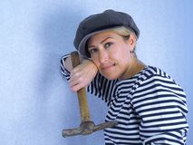 The woman with a hammer Royalty Free Stock Image