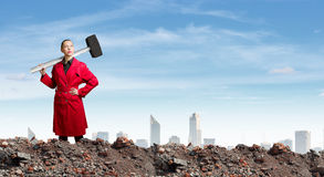 Woman with hammer Stock Photography