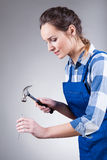 Woman with hammer and spike. Vertical view of woman with hammer and spike Stock Images