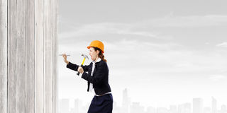 Woman with hammer Royalty Free Stock Photo