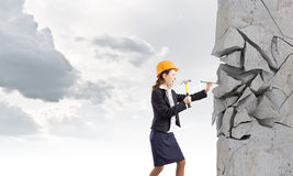 Woman with hammer Stock Images