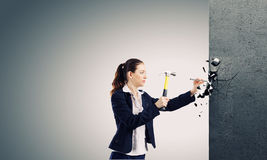 Woman with hammer Stock Photo