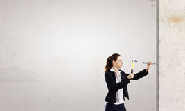 Woman with hammer Stock Image