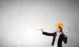 Woman with hammer Stock Photos