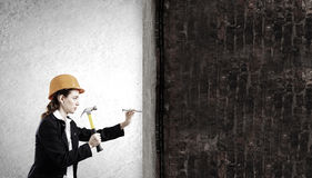 Woman with hammer Royalty Free Stock Photos