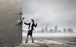 Woman with hammer Royalty Free Stock Image