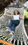 Woman on hammock stock photography
