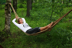 Woman in a hammock Stock Images