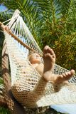 Woman on hammock Stock Photo