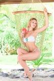 Woman in hammock Stock Photo