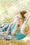 Woman in hammock. Portrait of woman resting in hammock Royalty Free Stock Images