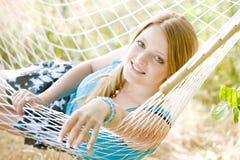 Woman in hammock. Portrait of woman resting in hammock Stock Photography