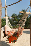 Woman in hammock Stock Image