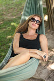 Woman in hammock Stock Photos