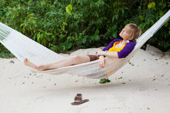 Woman in hammock. Young woman lying in a hammock Stock Photography